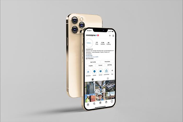 Eine Fotomontage eines Handyscreens mit einem Instagram-Konto der voestalpine.
